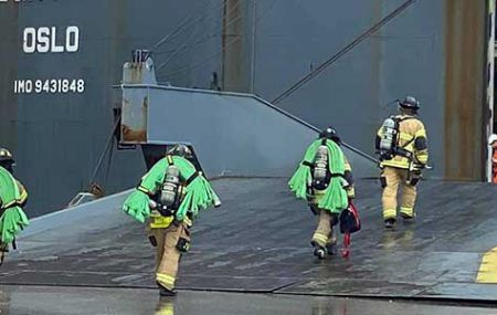 Firefighters entering a ship